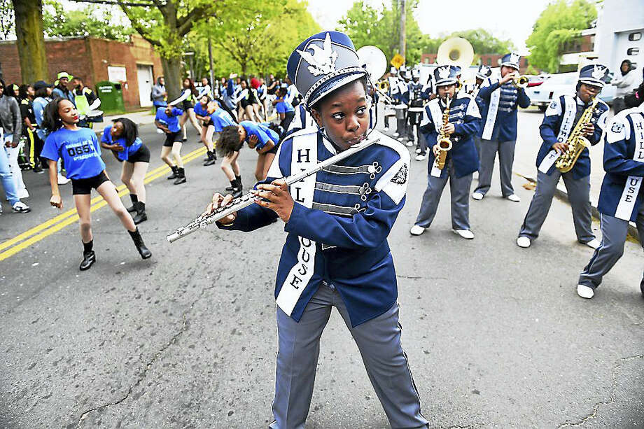 The Hillhouse High School Marching Band warms up Sunday before the start of the Freddy Fixer Parade on Dixwell Avenue in New Haven. The event drew out thousands of spectators. Photo: Photo By Arnold Gold — New Haven Register