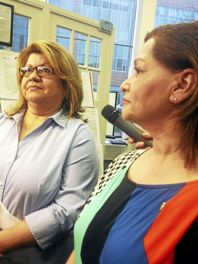 From left, Prisicilla Esposito and her sister, Gina Bucchier, both of Meriden, spoke to reporters at the Consulate of Ecuador in New Haven Monday. They have been unable to get on touch with relatives in the coastal area hit by an earthquake. Photo/Mary O'Leary Photo: Journal Register Co.
