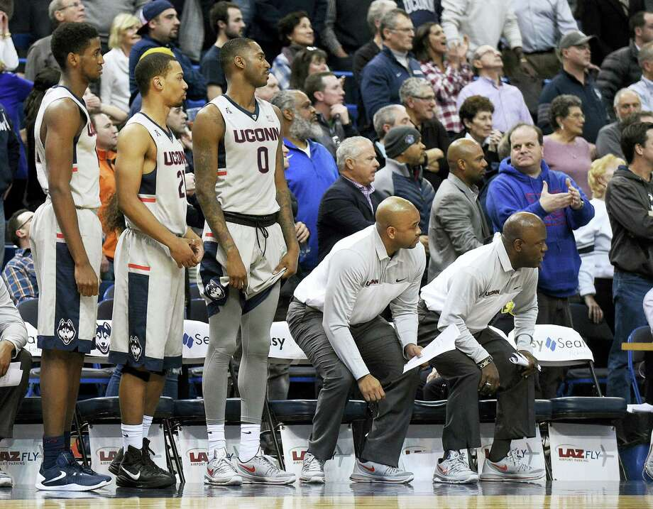 Connecticut players and coaches watch Cincinnati's game-winning free throw during Cincinnati's 58-57 victory in an NCAA college basketball game in Hartford, Conn., on Thursday, Jan. 28, 2016. (AP Photo/Fred Beckham) Photo: AP / FR153656 AP