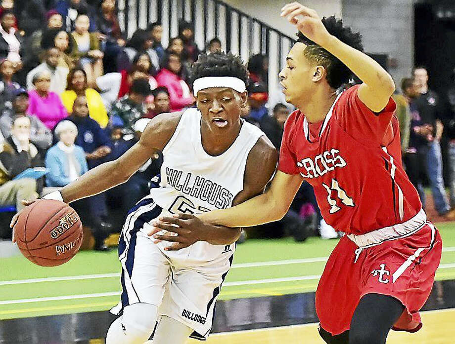 Hillhouse sophomore guard Byron Breland III drives as Cross junior guard Jayden Valderamma defends in a 78-76 overtime win for the Academics, Wednesday, January 27, 2016, Floyd Little Athletic Center in New Haven. Photo: Catherine Avalone — New Haven Register   / New Haven RegisterThe Middletown Press