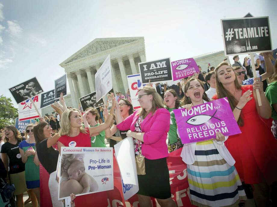 In this June 30, 2014 file photo, demonstrators react to hearing the Supreme Court's decision on the Hobby Lobby birth control case outside the Supreme Court in Washington. The Supreme Court rid itself on May 16, 2016 of a knotty dispute between faith-based groups and the Obama administration over birth control. Photo: AP Photo/Pablo Martinez Monsivais, File   / AP2014
