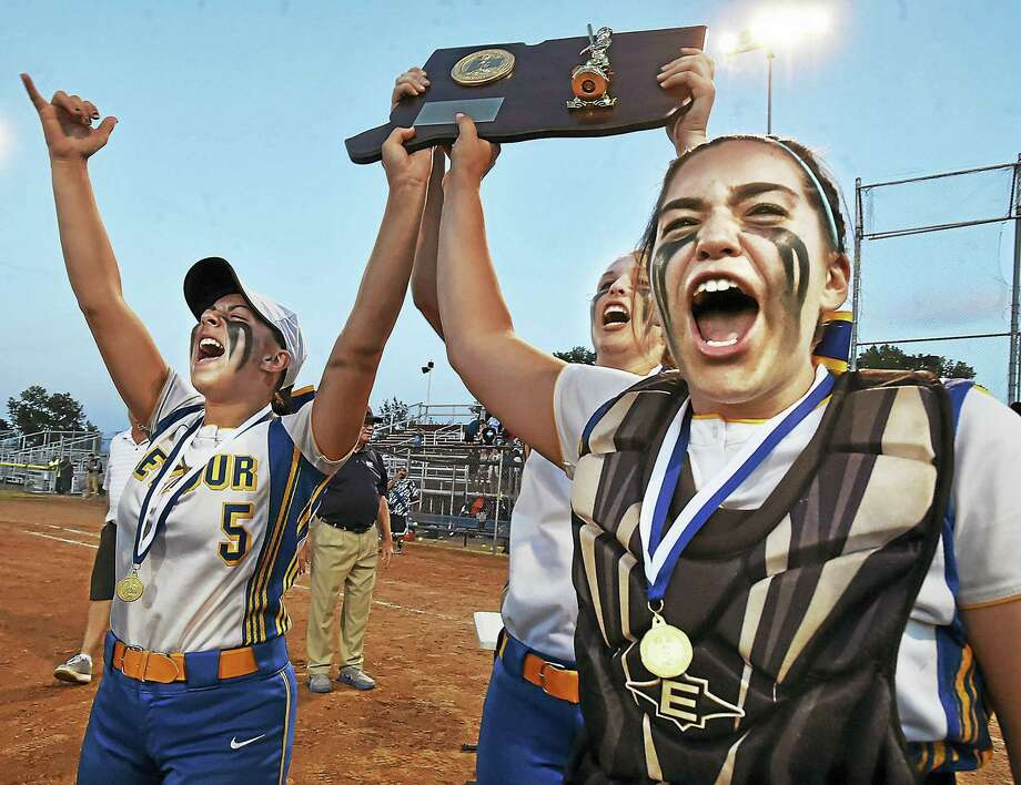 (Catherine Avalone - New Haven Register) Seymour senior captains Ashley Andes (5), Raeanne Geffert (15) and Amanda Harkins celebrate with the trophy their 1-0 class M state championship win over Rocky Hill, Friday, June 10, 2016, at DeLuca Field in Stratford. Not pictured is senior captain, Cassie Rosetti. Photo: Journal Register Co. / New Haven RegisterThe Middletown Press