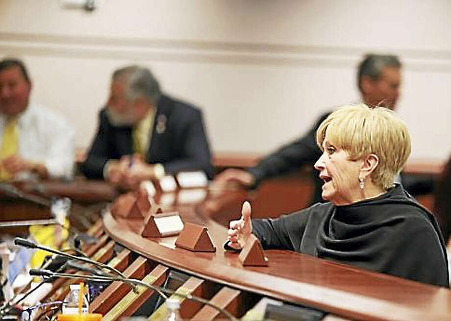 Kathleen Sanner, president of the union talks to lawmakers on the Appropriations Committee during a break. Photo: CHRISTINE STUART — CT NEWS JUNKIE