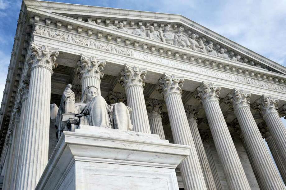 This Feb. 17, 2016 photo shows the Supreme Court in Washington. Challengers in two politically tinged cases at the Supreme Court this week face the seemingly insurmountable problem of being unable to count the five votes they need to prevail. The death of Justice Antonin Scalia has deprived conservatives of a reliable vote on a range of issues, and two of them are coming before the court. Photo: AP Photo/J. Scott Applewhite   / AP