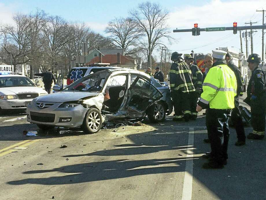 A man died and two other people were hurt in a serious three-vehicle crash late Thursday morning at the intersection of Townsend and Forbes avenues in New Haven. The intersection was shut down for hours after the accident as police investigated. Photo: (Wes Duplantier -- New Haven Register)