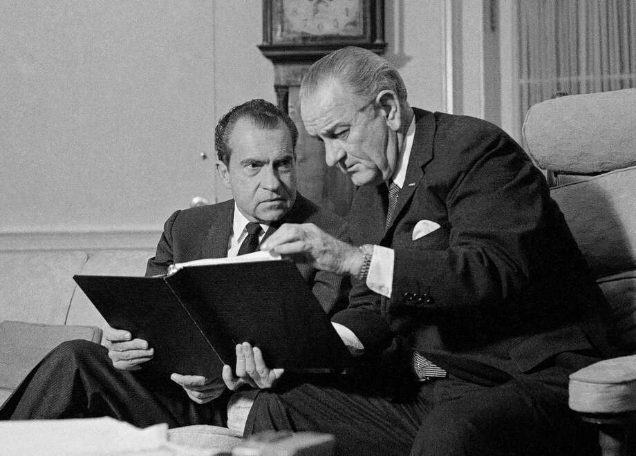 In this Dec. 12, 1968, photo, President Lyndon Johnson, right, confers with President-elect Richard Nixon in the White House in Washington. Photo: THE ASSOCIATED PRESS FILE PHOTO   / AP