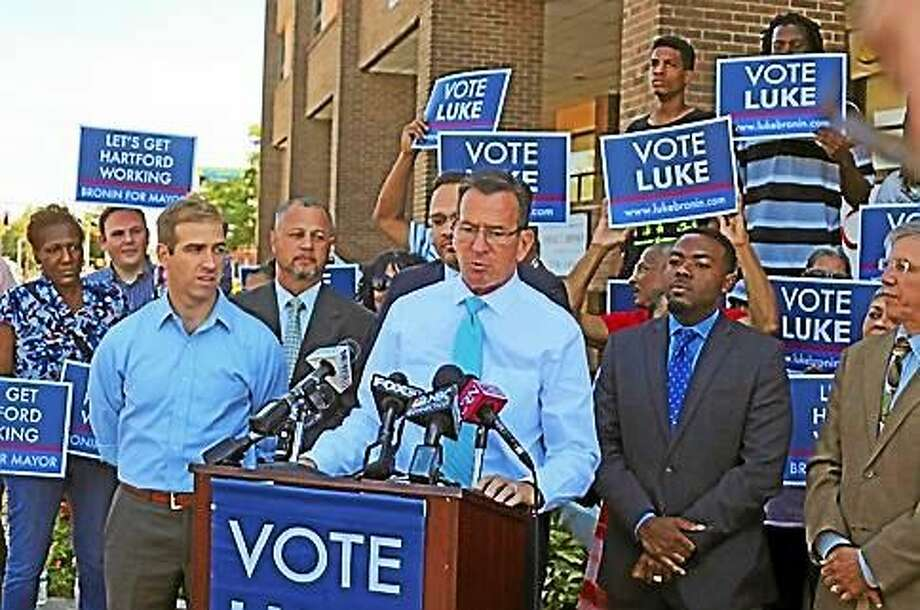 Luke Bronin and Gov. Dannel P. Malloy speak to reporters outside Bronin's North End campaign office. Photo: Christine Stuart Photo