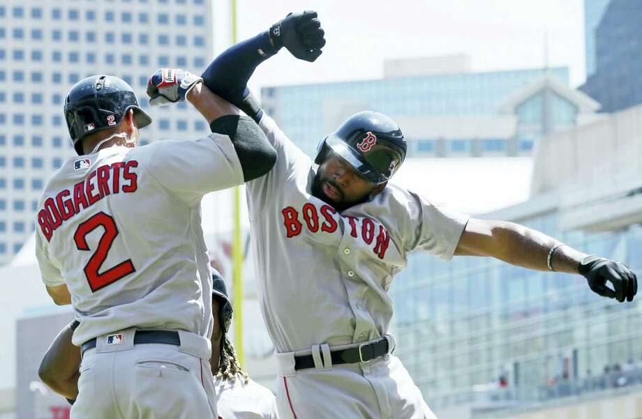 Jackie Bradley Jr., right, celebrates with Xander Bogaerts after Bradley's three-run home run in the first inning Saturday. Photo: Jim Mone — The Associated Press   / Copyright 2016 The Associated Press. All rights reserved. This material may not be published, broadcast, rewritten or redistribu
