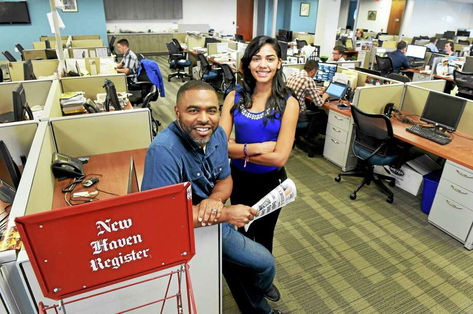 (Peter Hvizdak - New Haven Register) ¬ Community Engagement Editor Shahid Abdul-Karim and reporter  Juliemar Ortiz of the New Haven Register in the Register newsroom Tuesday September 18, 2015. Photo: ©2015 Peter Hvizdak / ©2015 Peter Hvizdak