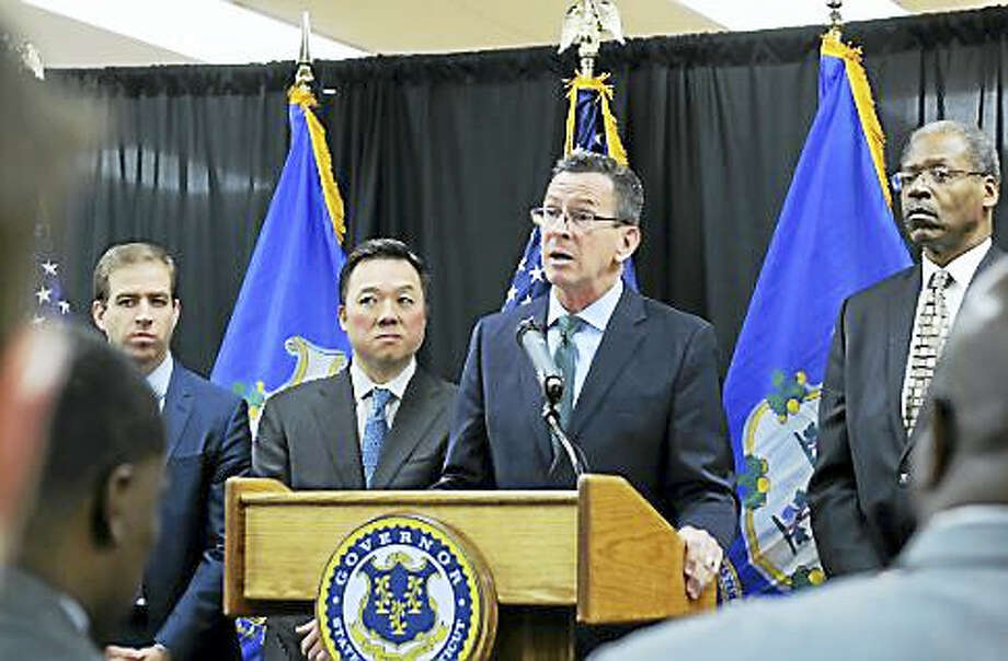 Gov. Dannel P. Malloy flanked by Hartford Mayor Luke Bronin, Rep. William Tong and Sen. Eric Coleman Photo: CHRISTINE STUART — CT NEWS JUNKIE