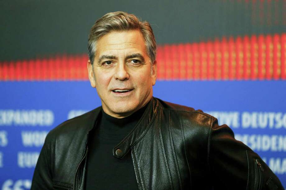 "In this Feb. 11, 2016 photo, actor George Clooney attends a news conference for the film ""Hail Caesar"" at the 2016 Berlinale Film Festival in Berlin. Clooney hosted weekend fundraisers in California on behalf of Democratic presidential candidate Hillary Clinton. Photo: AP Photo/Axel Schmidt, File   / AP"