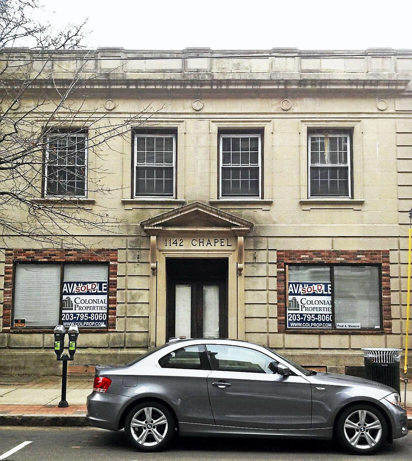Facade of 1142 Chapel St., a vacant building for 24 years that has been sold to Pike International. It will have commercial use on first floor with potential for residential upstairs with additional floors. Photo: Mary O'Leary — New Haven Register