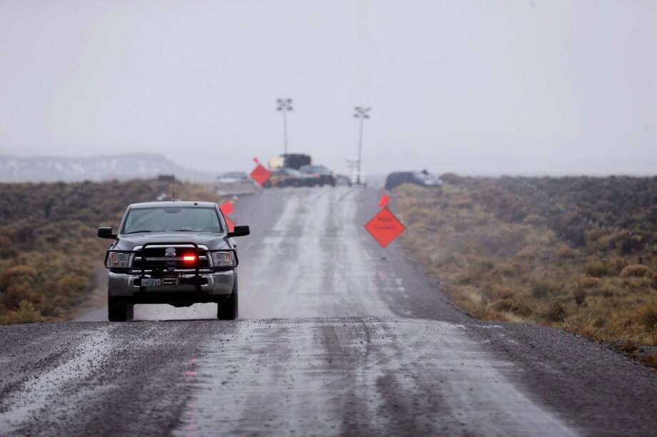 A law enforcement vehicle heads away from a roadblock near the Malheur National Wildlife Refuge in Harney County, Ore., Jan. 28, 2016. Photo: Beth Nakamura/The Oregonian Via AP  / The Oregonian