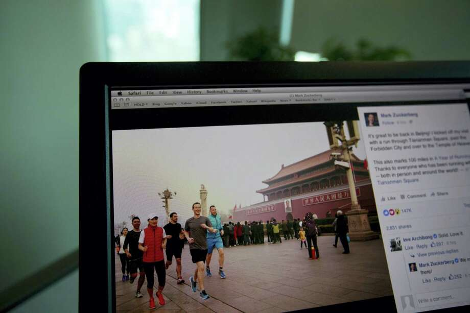 A computer screen displays the social media posting by Mark Zuckerberg on Facebook in Beijing, China on March 18, 2016. The photo of Facebook founder Mark Zuckerberg jogging in downtown Beijing's notorious smog has prompted a torrent of astonishment, mockery and amusement on Chinese social media. Photo: AP Photo/Ng Han Guan   / AP