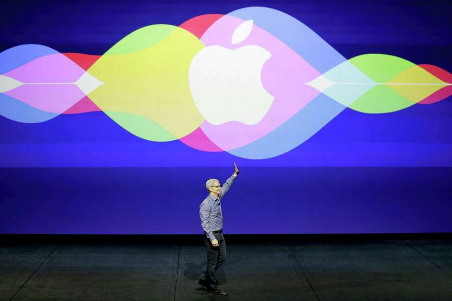 In this  Sept. 9, 2015 photo, Apple CEO Tim Cook waves during the Apple event at the Bill Graham Civic Auditorium in San Francisco. Apple is expected to unveil some new additions to its current family of iPhone and iPad devices at the company's product announcement on Monday, March 21, 2016. Photo: AP Photo/Eric Risberg, File   / Copyright 2016 The Associated Press. All rights reserved. This material may not be published, broadcast, rewritten or redistributed without permission.