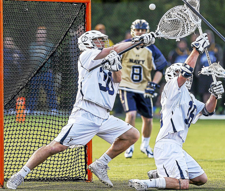 Yale goaltender Hoyt Crance (30) makes a save with the help of Mark Glicini during Sunday's 13-10 loss to Navy. Photo: John Vanacore — For The Register   / (c)John H.Vanacore/Register