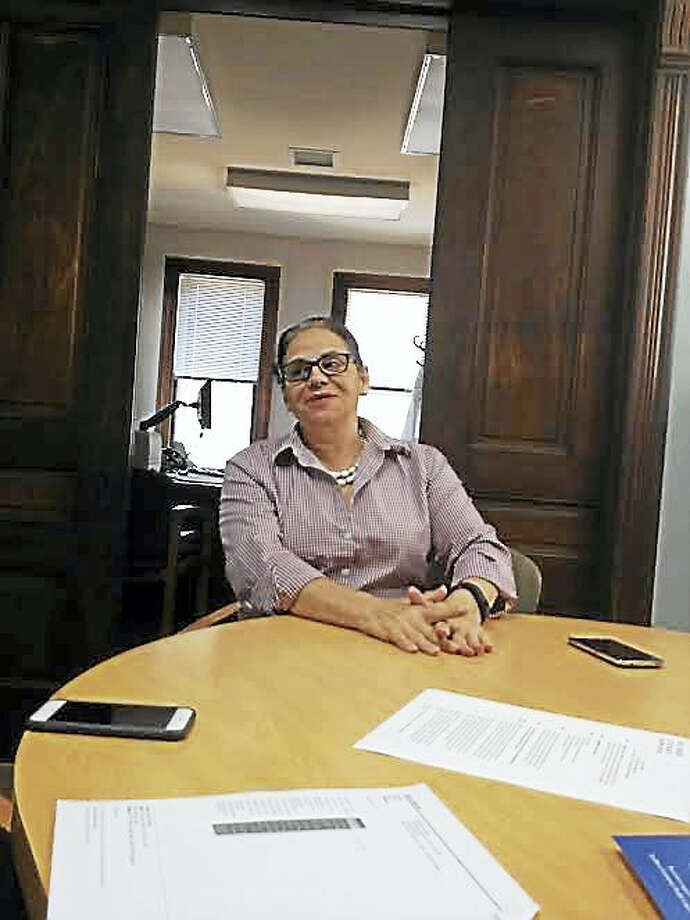 Vivian  Acevedo-Rivas who has worked at the health clinic for decades, said there is now a lot of collaboration among agencies. Photo: Mary E. O'Leary — New Haven Register