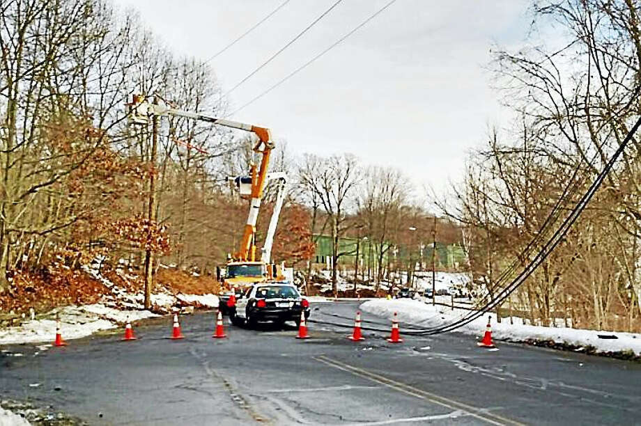 Part of Sherman Avenue was shut down Wednesday morning near the Quinnipiac University York Hill campus after a vehicle took down a utility pole in an overnight crash. Photo: Photo Courtesy Of The Hamden Police Department