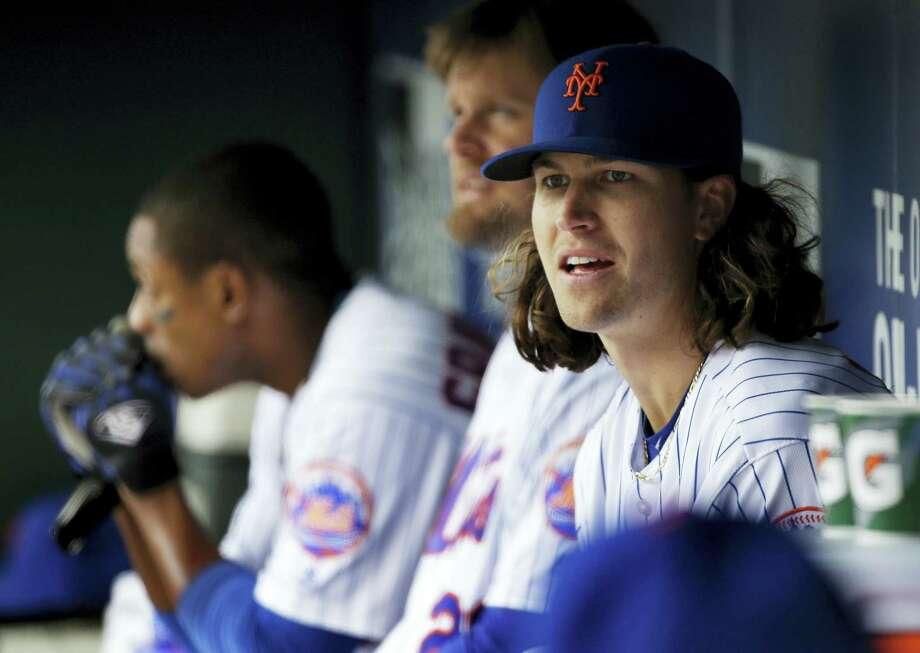 Mets pitcher Jacob deGrom was placed on the family medical emergency list because of health complications involving his newborn child. Photo: The Associated Press File Photo   / AP