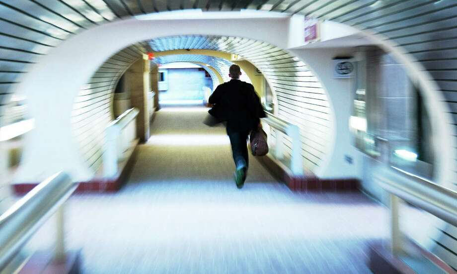 A commuter runs at Union Station for a Metro North train bound for Grand Central Terminal. Photo: File Photo