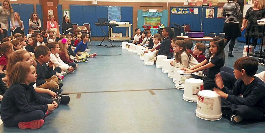 "Students at Overbrook School in East Haven use buckets as instruments during their ""Have You Filled a Bucket Today?"" assembly Monday, where they learned about kindness. Photo: Juliemar Ortiz — New Haven Register"