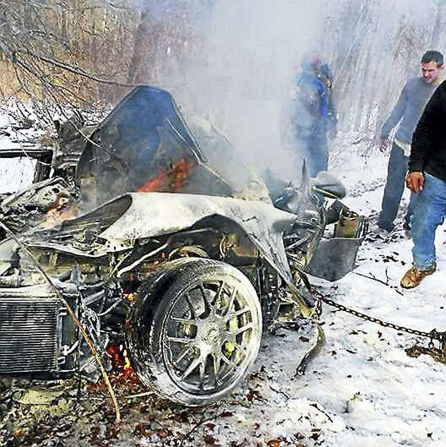 A Woodbridge man lost control of his sports car and crashed into a tree Tuesday on Route 15 near Exit 59 in Woodbridge, police have said. The car caught fire and the man was hospitalized with serious injuries. Photo: Courtesy Of Ray Paige