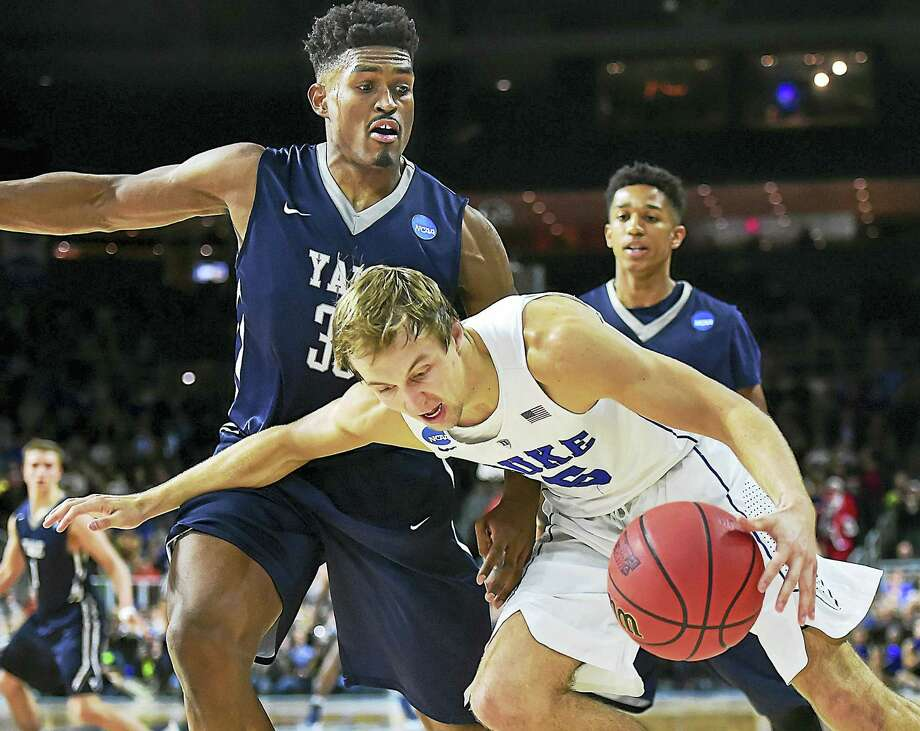 Yale senior forward Brandon Sherrod presses Duke guard Luke Kennard in the final seconds as the Blue Devils defeat the Bulldogs, 71-64, Saturday, March 19, 2016, in the second round of the 2016 NCAA Men's Basketball Tournament at the Dunkin' Donuts Center in Providence, RI.  (Catherine Avalone/New Haven Register) Photo: Journal Register Co. / New Haven RegisterThe Middletown Press