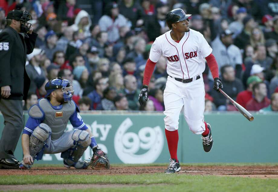 Xander Bogaerts watches the flight of his three-run home run in the third inning on Saturday. Photo: Mary Schwalm — The Associated Press   / FR158029 AP
