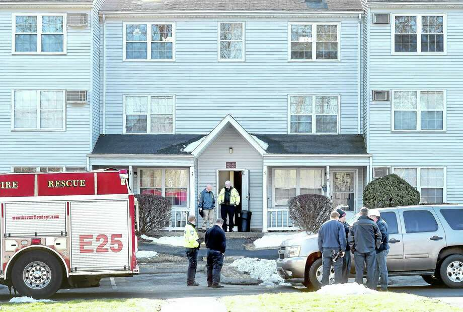 West Haven Police and Fire Department officials on the scene of a homicide at the Mallard Brook Crossing Condominiums Saturday. Photo: Arnold Gold — New Haven Register