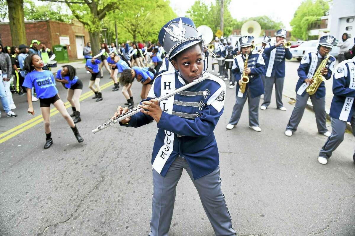 (Arnold Gold-New Haven Register) The Hillhouse High School Marching Band warms up before the start of the Freddy Fixer Parade Sunday.
