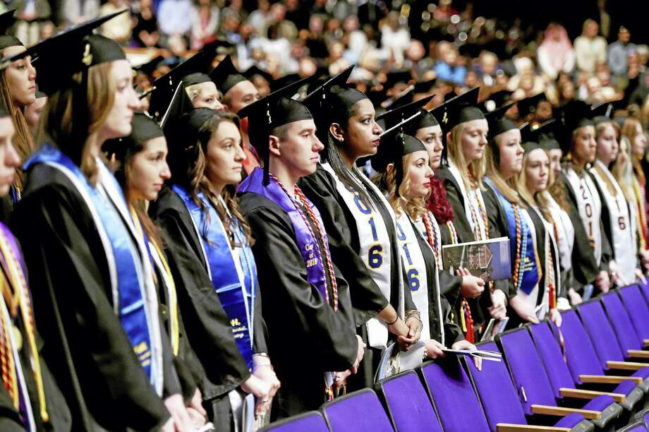 Graduates listen to University of New Haven President Steven Kaplan speak at commencement exercises at the Toyota  Oakdale Theatre in Wallingford. Photo: Arnold Gold — New Haven Register