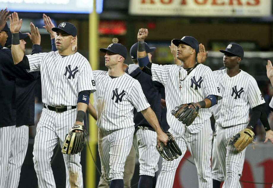 Members of the Yankees celebrate after Friday's win over the Tigers. Photo: Frank Franklin II — The Associated Press   / Copyright 2016 The Associated Press. All rights reserved. This material may not be published, broadcast, rewritten or redistribu