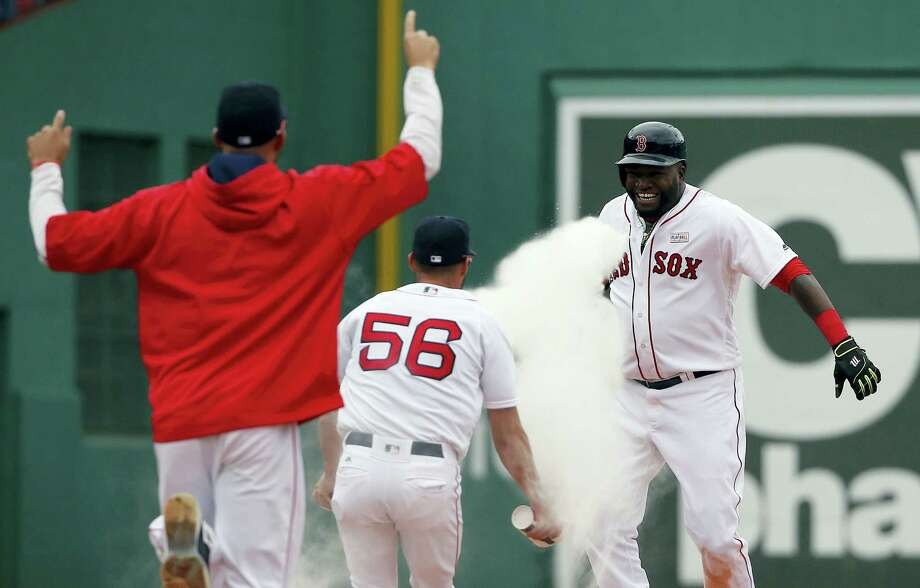David Ortiz, right, celebrates his game-winning double in the 11th inning against the Astros on , Saturday. Photo: Michael Dwyer — The Associated Press   / AP