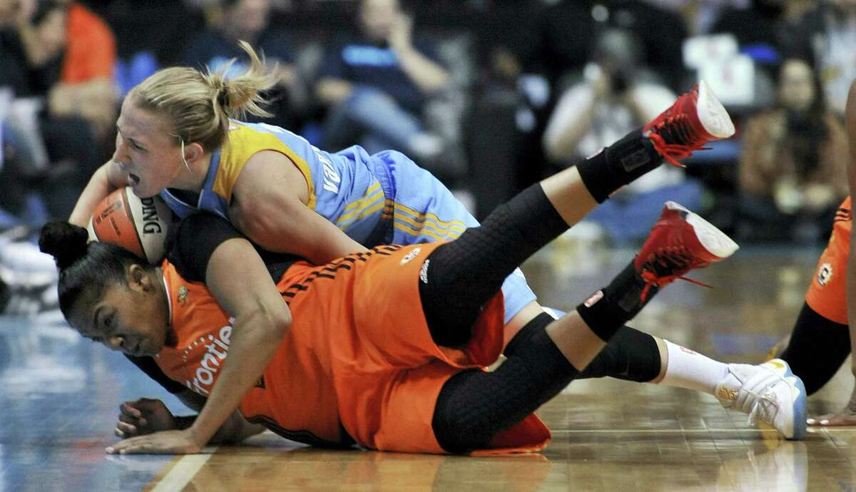 The Sky's Courtney Vandersloot, top, vies with the Sun's Alex Bentley, bottom, for a loose ball during Saturday's game.
