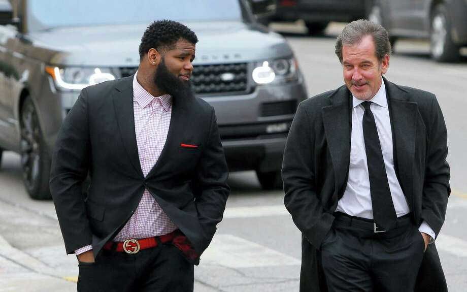 The Jets' Sheldon Richardson, left, walks towards the St. Charles County courthouse with his lawyer Scott Rosenblum Tuesday in St. Charles, Mo. Photo: David Carson — St. Louis Post-Dispatch Via AP   / St. Louis Post-Dispatch