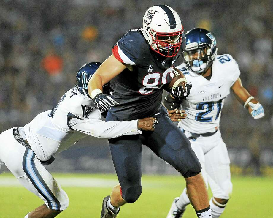 UConn tight end Tommy Myers (80) pulls away from Villanova defensive back Trey Johnson during a game last season. Photo: The Associated Press File Photo   / FR125654 AP