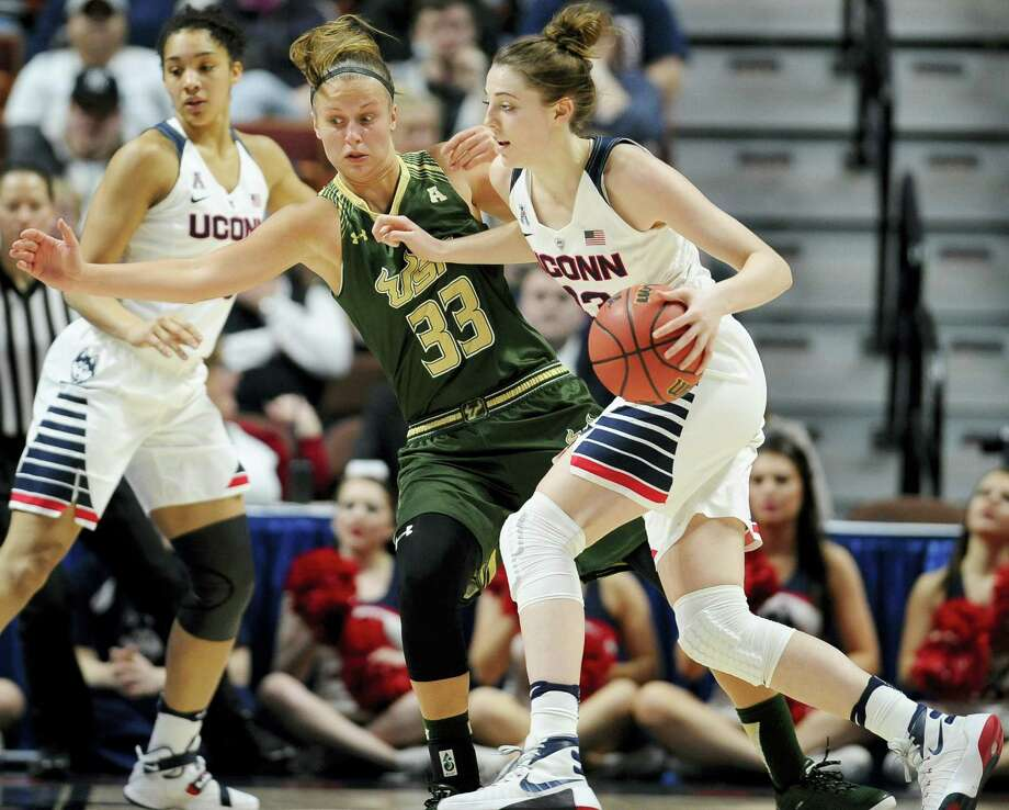 Connecticut's Katie Lou Samuelson dribbles past South Florida's Kitija Laksa (33) during the second half of an NCAA college basketball game in the American Athletic Conference tournament finals at Mohegan Sun Arena, Monday, March 7, 2016, in Uncasville, Conn. (AP Photo/Jessica Hill) Photo: AP / FR125654 AP