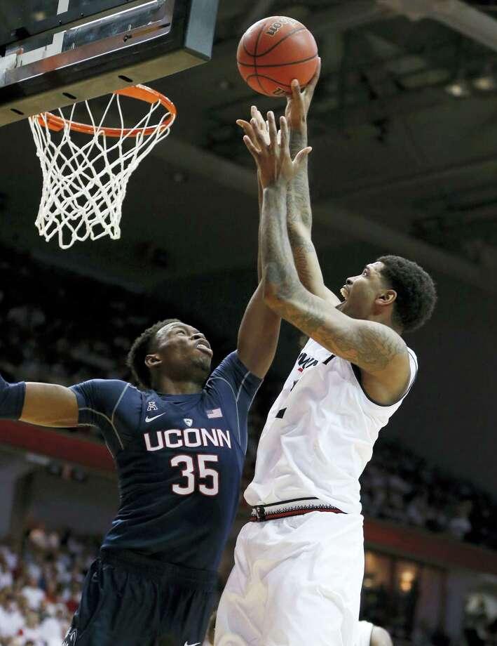 Cincinnati's Octavius Ellis, right, shoots against UConn's Amida Brimah during the first half on Saturday. Photo: Gary Landers — The Associated Press   / FR171284 AP