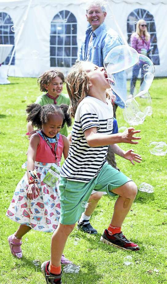 Will Freeman, 8, of New Haven pops a bubble with his tongue during Foote School's Centennial Weekend in New Haven. Photo: Arnold Gold — New Haven Register