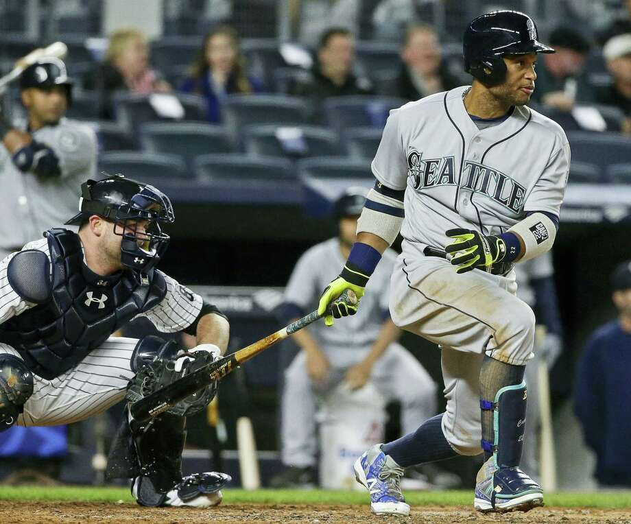 Robinson Cano follows through on an RBI single during the fourth inning Friday. Photo: Frank Franklin II — The Associated Press   / Copyright 2016 The Associated Press. All rights reserved. This material may not be published, broadcast, rewritten or redistributed without permission.