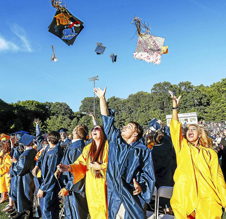 The 2016 graduating class of East Haven High School celebrates at the conclusion of commencement exercises Friday evening. Photo: John Vanacore — FOR THE Register   / John H.Vanacore/Register