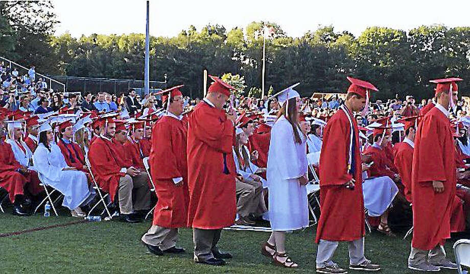 Cheshire High School seniors march during graduation Friday. Photo: LUTHER TURMELLE — NEW HAVEN REGISTER