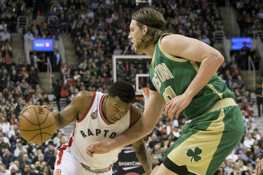 Toronto Raptors' Kyle Lowry, left, drives against Boston Celtics' Kelly Olynyk during second-half action in Toronto, Friday. Photo: Chris Young — The Canadian Press Via AP   / The Canadian Press