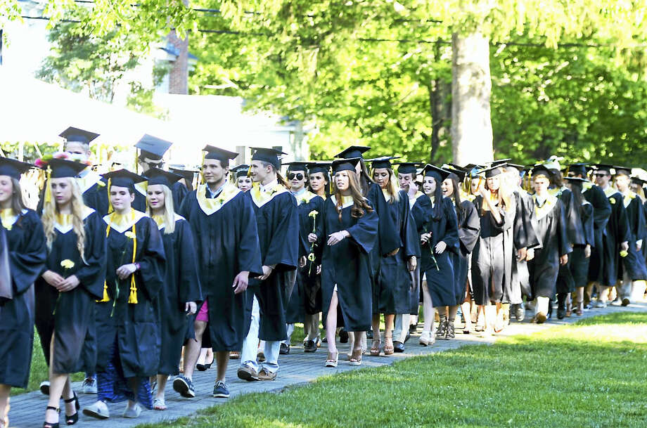Daniel Hand graduates march during commencement exercises Friday. Photo: Photo By Kelly Goddard