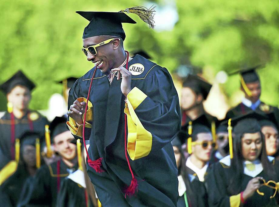 Gabriel Haynes, a member of Jonathan Law High School's class of 2016, is called to receive his diploma Friday in Milford. Photo: Catherine Avalone — New Haven Register   / New Haven RegisterThe Middletown Press
