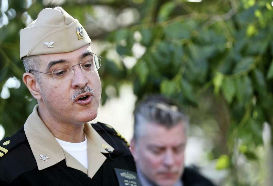 Capt. Jose Acosta speaks to members of the media during a news conference about reports of gunshots at a building on the campus Tuesday, Jan. 26, 2016, in San Diego. The Navy said Tuesday an initial inspection at Naval Medical Center San Diego found no sign of a gunman or a shooting. Photo: AP Photo/Lenny Ignelzi / AP