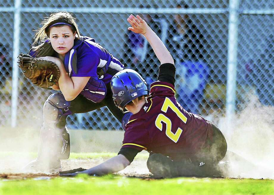 Sheehan junior Emily Frankie is out at home in the bottom of the fifth by North Branford senior catcher Sabrina LeMere in a 6-3 win Thursday for the Thunderbirds at Sheehan High School in Wallingford. Photo: Catherine Avalone — New Haven Register    / New Haven RegisterThe Middletown Press