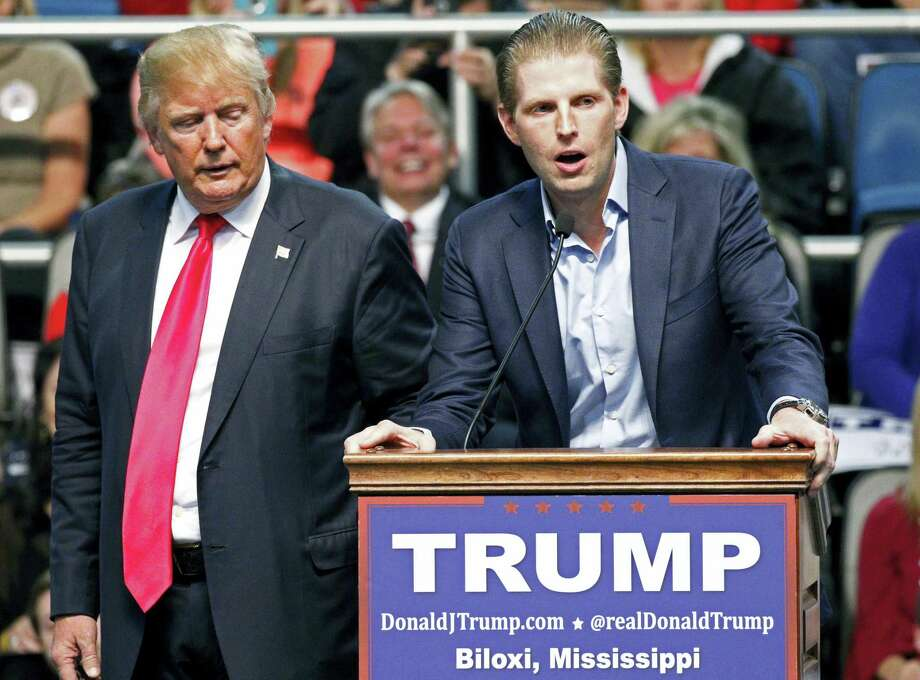 In this Jan. 2, 2016 file photo, Republican presidential candidate Donald Trump, left, listens as his son Eric Trump speaks during a rally in Biloxi, Miss. A law enforcement official says New York City police and the FBI are investigating a threatening letter sent to the Manhattan apartment of Eric Trump. The official says the envelope sent to Eric Trump's apartment on Thursday, March 17, 2016, contained a suspicious white powder and a threatening letter. There were no injuries and the official said preliminary tests indicated that the white substance was not hazardous. Photo: AP Photo/Rogelio V. Solis    / AP