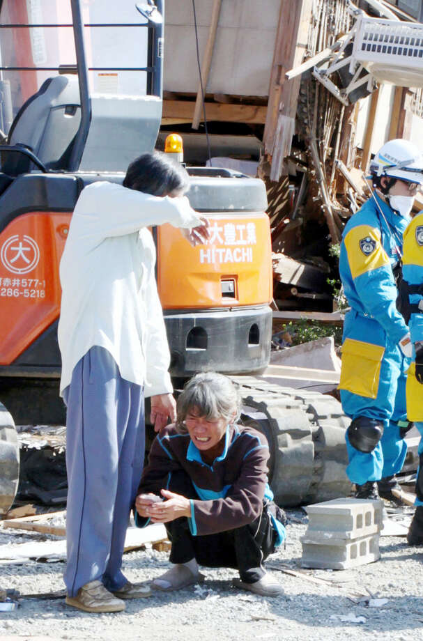 Parents cry as they confirm that their daughter was found dead after an earthquake in Mashiki, Kumamoto prefecture, southern Japan Saturday, April 16, 2016. A major quake shook southwestern Japan, barely a day after another quake hit the same region. Photo: Ryota Tajiri — Kyodo News Via AP / Kyodo News