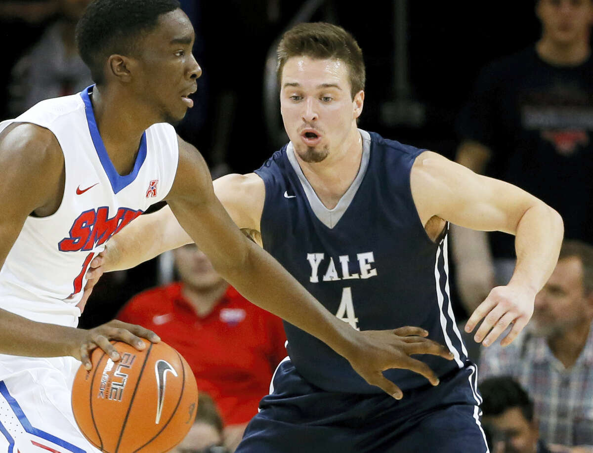 In this Nov. 22, 2015, photo, Yale's Jack Montague, right, defends against SMU guard Shake Milton during an NCAA college basketball game in Dallas.